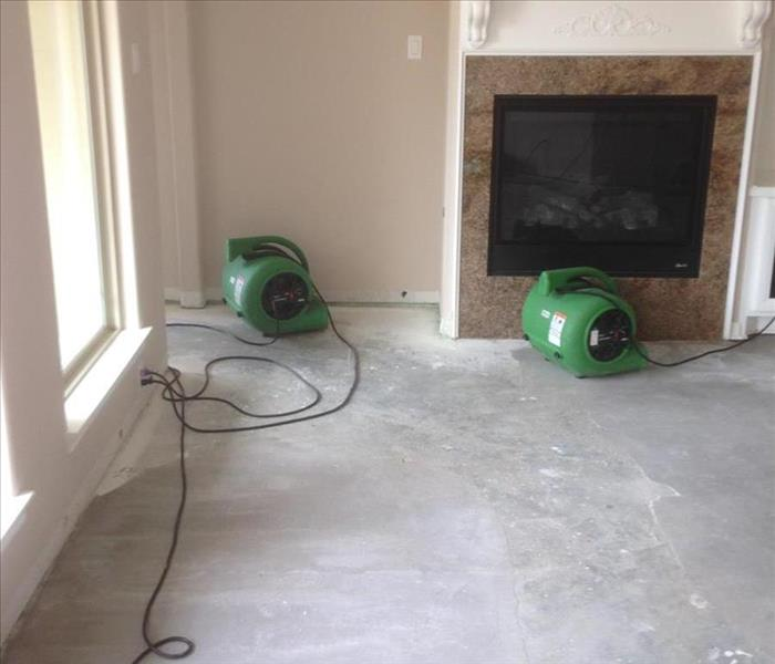 servpro equipment drying cement under wood flooring