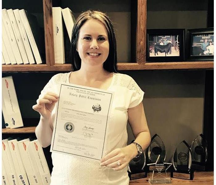 Julie holding her certificate of notary